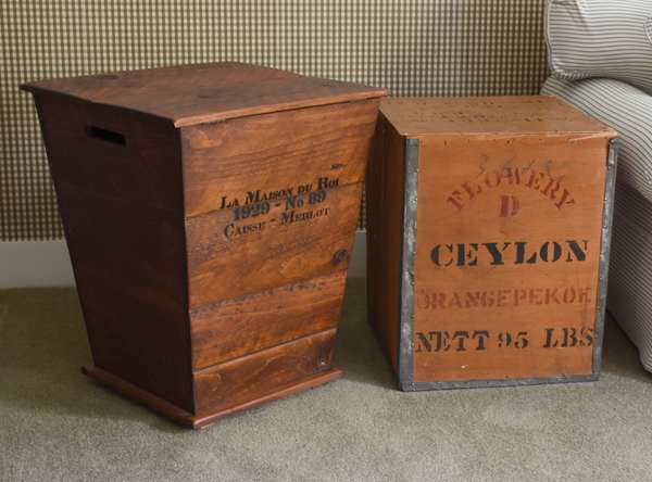 Two wooden advertising bins used as end tables, ceylon tea along with grape bin
