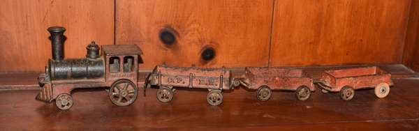 Late 19th C. cast iron train toy, engine and cars in original paint, four pieces, 23
