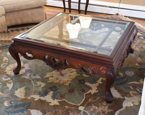 Modern carved wood and glass top coffee table in traditional style, 40