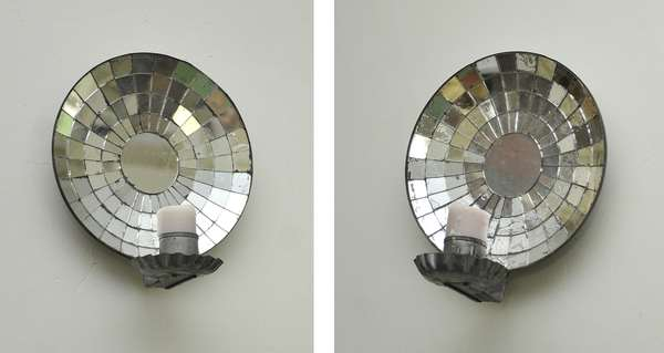Pair of mirrored crimped tin wall sconces, 8