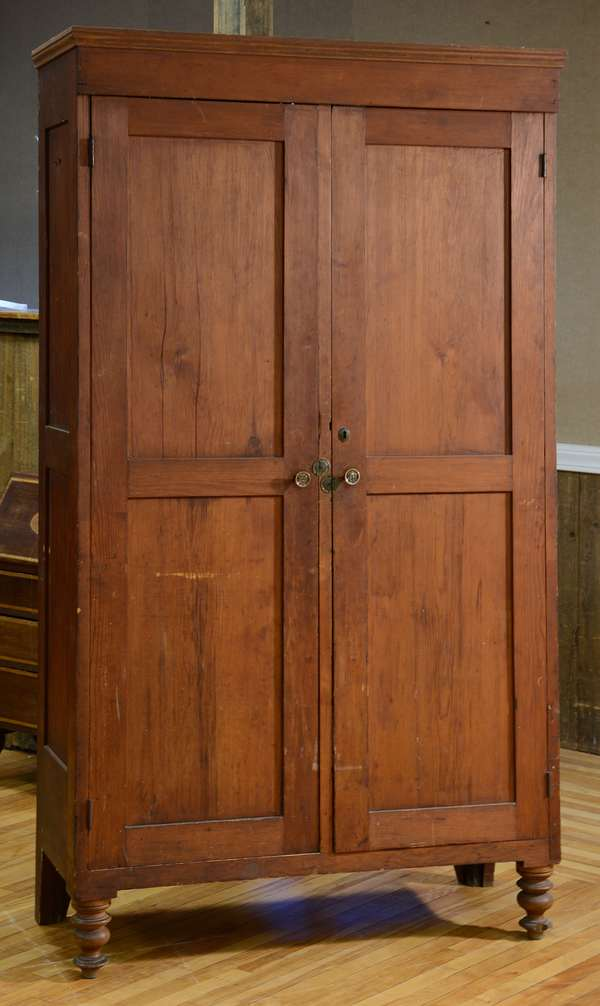 Good large 19th C. two door pine paneled floor cupboard on turned feet, old color, 85