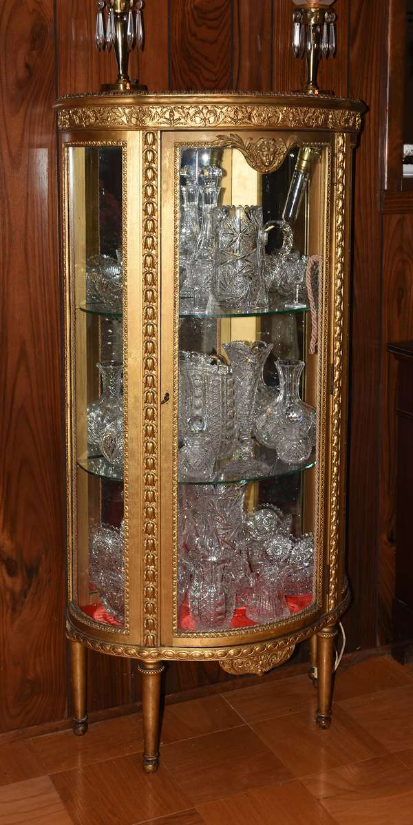 Several good gilt decorated vitrines and large selection of cut glass