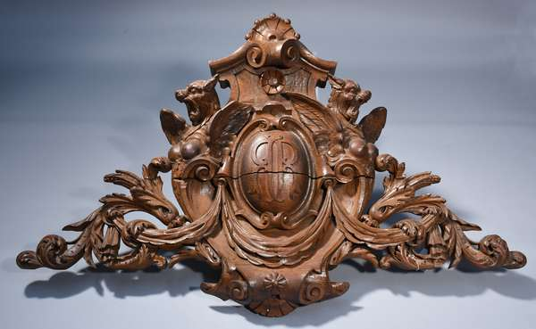 Impressive 19th C. carved oak crest. Gargoyles and floral swags flank an oval cartouche with back to back