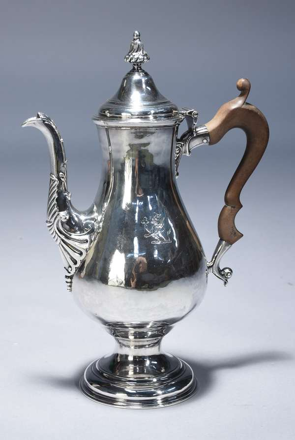 American 18th C. silver coffee pot by Joseph Smith, Boston.  Pyriform on footed base, family crest on side wood handle stamped  I.S. in a rectangle, what appears to be original sterling stamp, 13.5