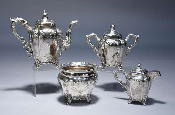 American coin silver.  Four piece coffee and tea set by Gale & Hyden, New York, dated 1846.  Acanthus scroll feet, repousse floral panels, chased handle and spout with diapered ground at spout base.  Coffee pot 9.75