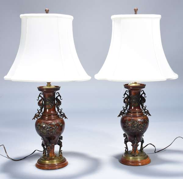 Pair of 19th C. Chinese bronze vases converted to lamps, electrified.  Floral and bird decoration, bird form feet.  Vase 14.5
