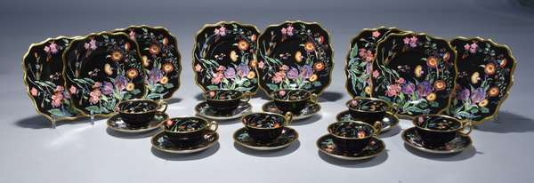 24 piece Wedgwood luncheon/dessert set.  Black background withvibrantly painted floral decoration, service for eight. eight-8