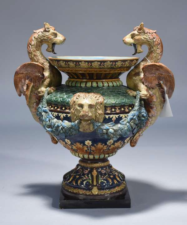 W. Schiller & Sons 19th C. Majolica griffin handled urn.  Intricate detail with very good coloration.  20.5