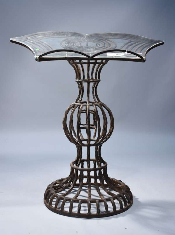 Mid-Century wrought iron lectern.  Top shaped like a butterfly, with the stem being a raised step base transitioning into a sphere with a tapered sphere above that.  Very substantial, could be used inside or outside, 46