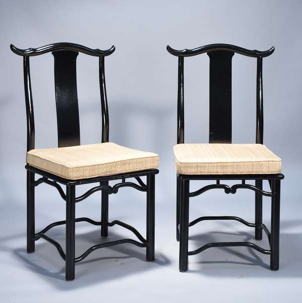 Eight black lacquer Chinese yoke back chairs.  Cane seat with applied silk cushions, 40.5