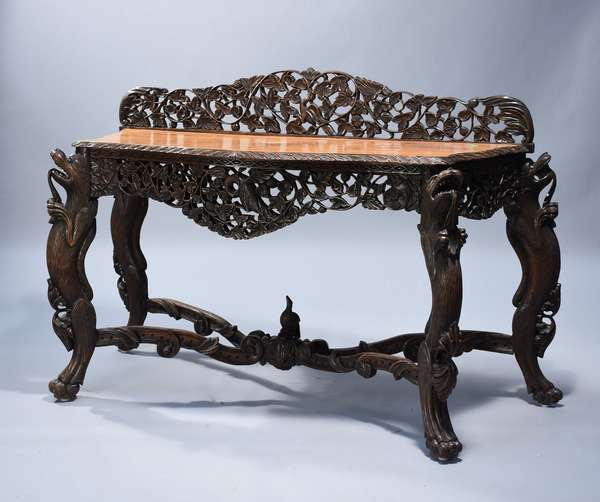 19th C. India Trade hardwood carved console.  Full figure carved animal supports, cross stretcher base with bird, pierced carved apron and backsplash.  58