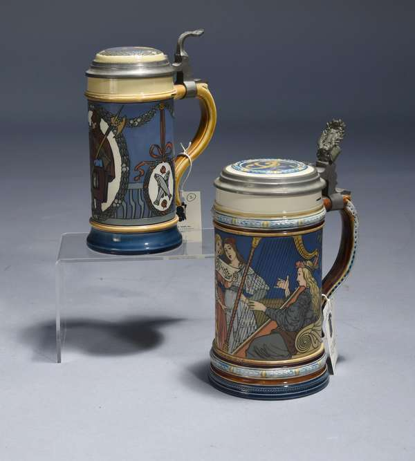 Two Mettlach etched steins, #2581 & 2937 1/2 L. three women singing with two women accompanying  on harp and lute, signed F. Quidenus inlay lid; 1/2 L. night watchman blowing horn, inlay lid, both with impressed castle mark Mettlach.  9