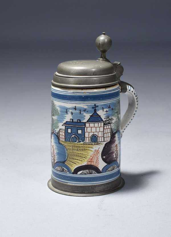 Faience stein with pewter mounts, multi-colored scene with buildings, trees and birds.  Pewter hallmarks, dated 1762 on lid, 8.75