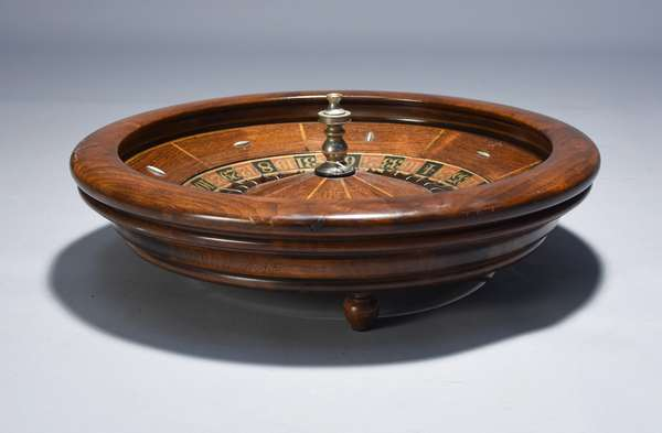 H.C. Evans antique roulette wheel, table top model in mahogany, very well made and functional.  22
