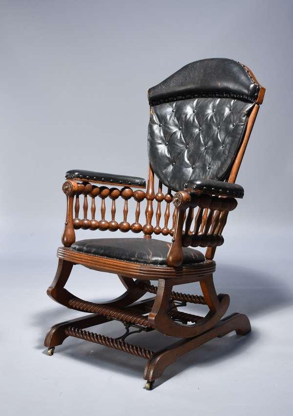 Signed Hunzinger stick and ball oak platform rocker.  Original leather upholstery and original finish.  43
