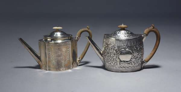 Two English Geo III teapots, one 1796 Henry Chawner, 14 oz, oval chased body; one 1786 Robert Hennell, 12 oz, scalloped body with bright cut engraving, both with wooden handles and finials, 6