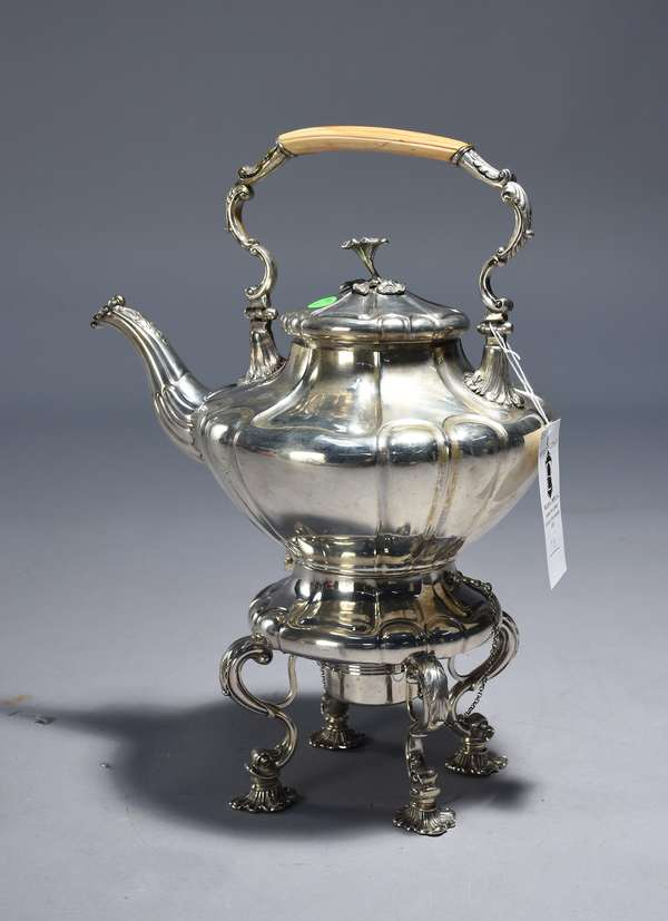 Continental silver kettle on stand.  Hand raised with cast dolphin and shell feet, 17.5