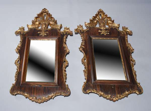 Pair of Portugese 18th C. carved and gilt rosewood mirrors.  Pierced carved crest, 39.5