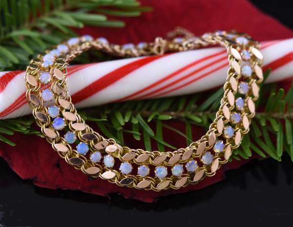 14k yg bracelet with small opals, 9.2 grams