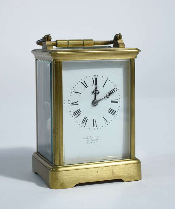 Brass & glass carriage clock, porcelain dial signed JE. Caldwell, Phila. 5.25