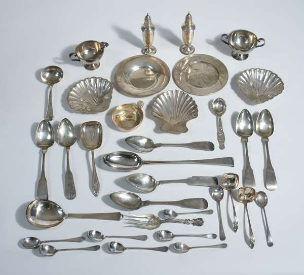 Good lot of estate sterling, Tiffany & Co. and Kirk & Sons nut dishes, salt & peppers, serving pieces, creamer/ sugars, etc., approx. 54 ozt, 25 sterling pieces along with seven coin spoon and large stuffing spoon (hallmarked),