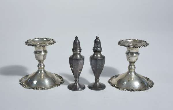 Pair of sterling hollowware candlesticks along with salt & pepper shakers, 4 pcs, approx. 14.5 ozt