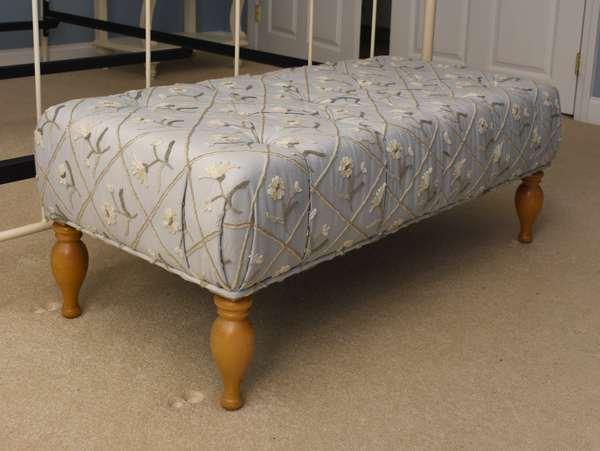 Upholstered Lee Industries ottoman on turned legs, 44