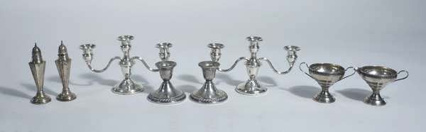 Large lot of weighted sterling including candelabras, candle ticks, salt & peppers etc., 8 pcs
