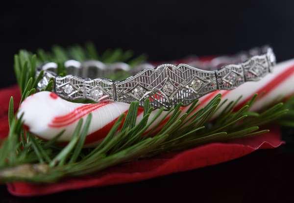 14k white gold filigree link bracelet with 19 diamond melee, 7.6 grams