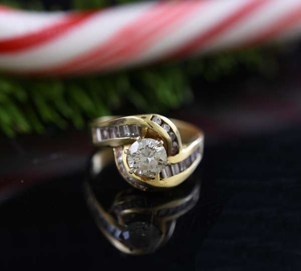 14k yellow gold and diamond ring, round diamond approx. .75ct. with other diamonds