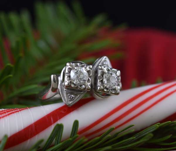 Ladies 14k white gold double pear shape mounting each set with single round diamonds, 3.9 grams