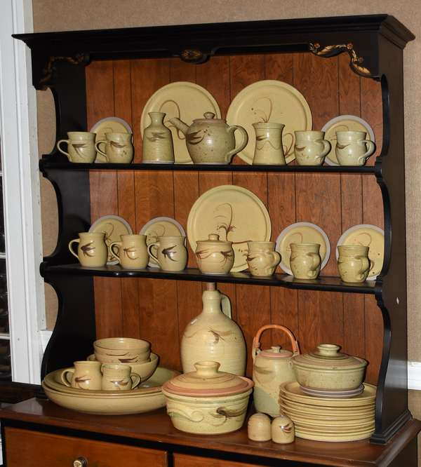 Nice collection of 48 pieces of Russell Collins stoneware, dinner plates, mugs, serving pieces, etc.