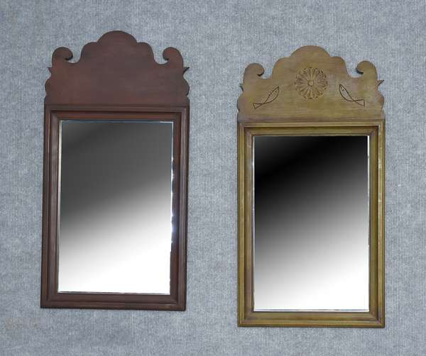 Two labeled Eldred Wheeler Queen Anne style courting mirrors, one with carved details in scrolled crest, red and green stains, 24.5