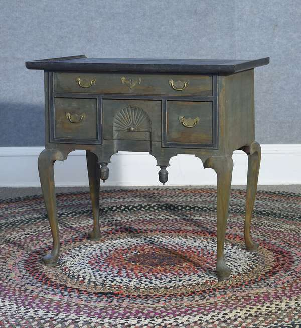 Labeled Eldred Wheeler Queen Anne style dressing table with inset slate top and fan carved block front drawer, green stain, 31.5