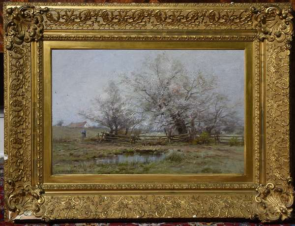 Oil on canvas, flowering trees in a country landscape with figure, signed