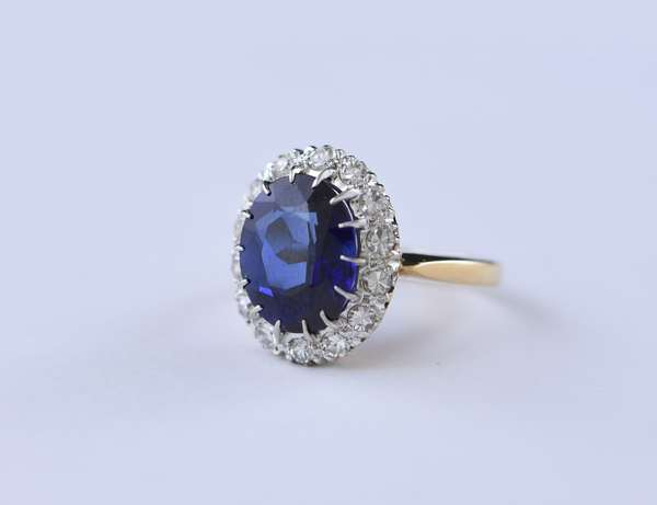 Synthetic sapphire and diamond ring, oval sapphire measures 10.5 mm x 12.1 mm, approx. 5.7 grams, ring size 6