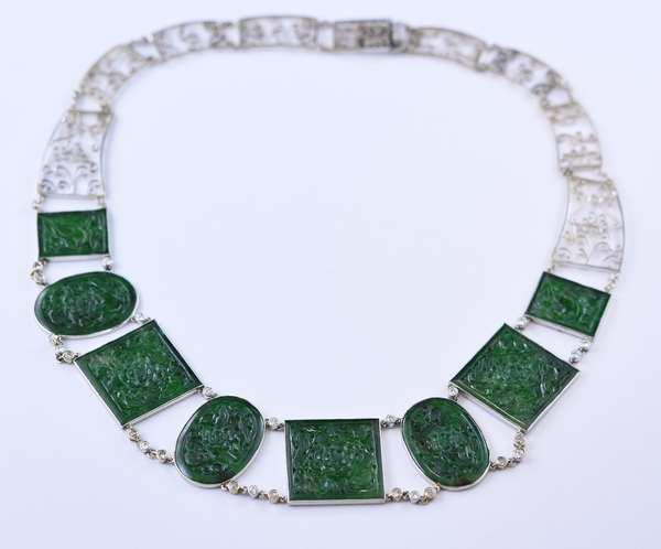 Stunning platinum diamond and carved jade necklace, eight carved green jade medallions conjoined with 26 diamond links