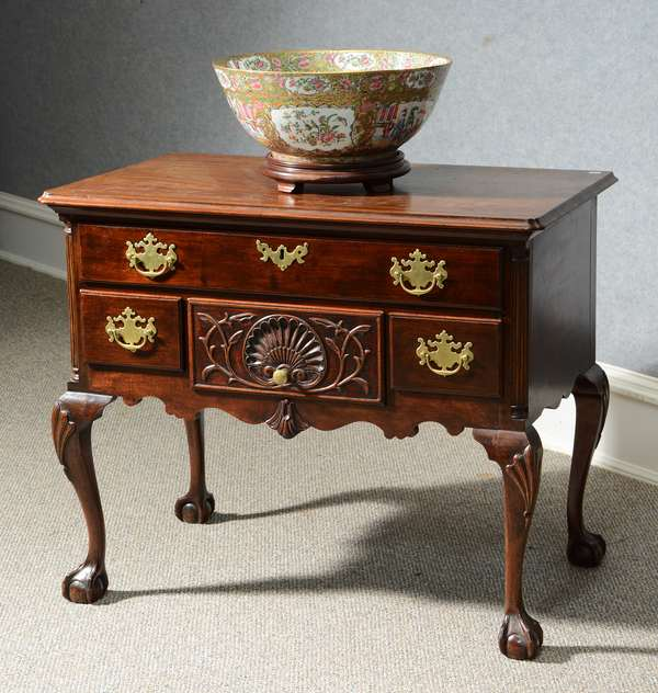 18th C. carved PA walnut Chippendale lowboy with fluted quarter columns, shell & vine carved center drawer, fan carved knees over claw & ball feet, Phila. area Ca 1760-80's, 32
