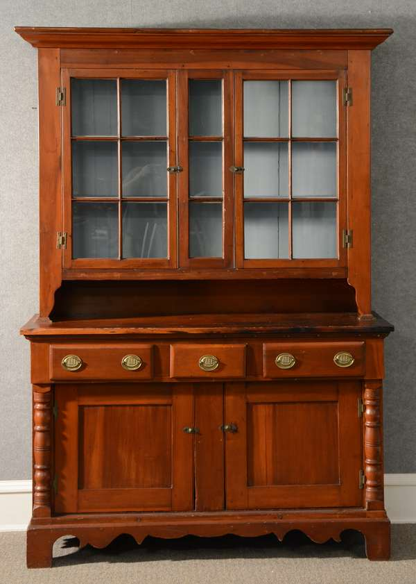 19th C. PA poplar and pine two-part set-back cupboard with sectional glass door top, lower case with an arrangement of drawers and doors with applied turned columns on bracket base, 57