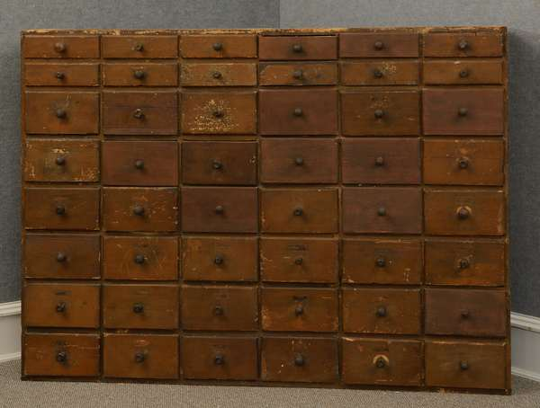 19th C. dovetailed 48 drawer apothecary in old surface, 69