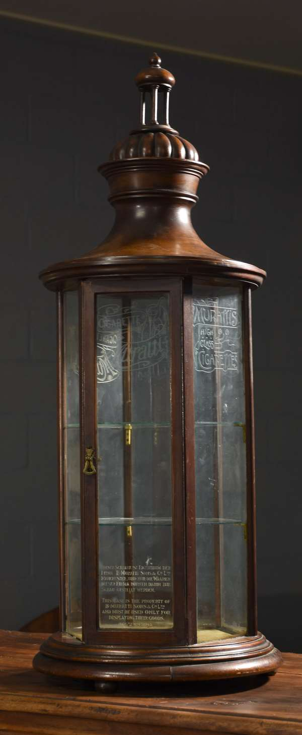 19th C./ early 20th C. carved walnut and etched glass Muratti's cigarette store display cabinet, six sides all with original etched glass advertising panels, 38