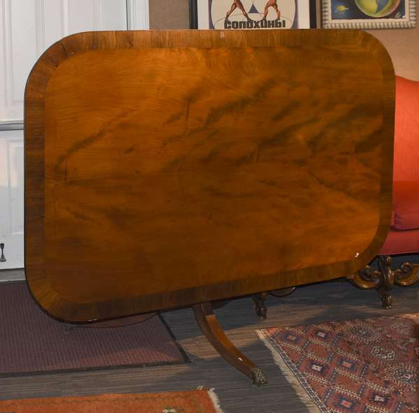 An exceptional English Regency large size tilt top breakfast table, exotic plum pudding mahogany with rosewood banding, top 72