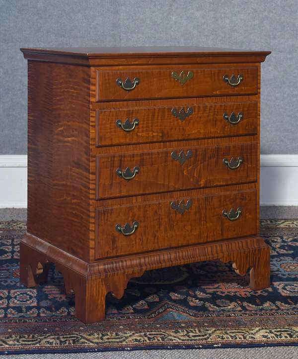 Sweet child's size tiger maple four drawer Chippendale style chest, labeled Eldred Wheeler, 22