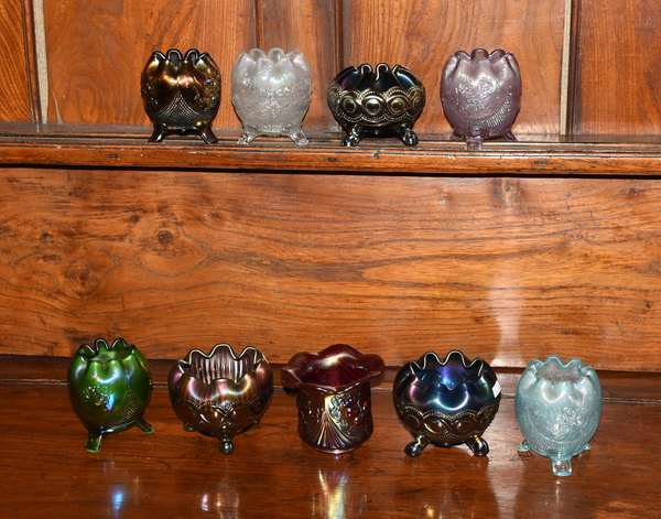 Nine Carnival glass footed rose bowls (379-52)