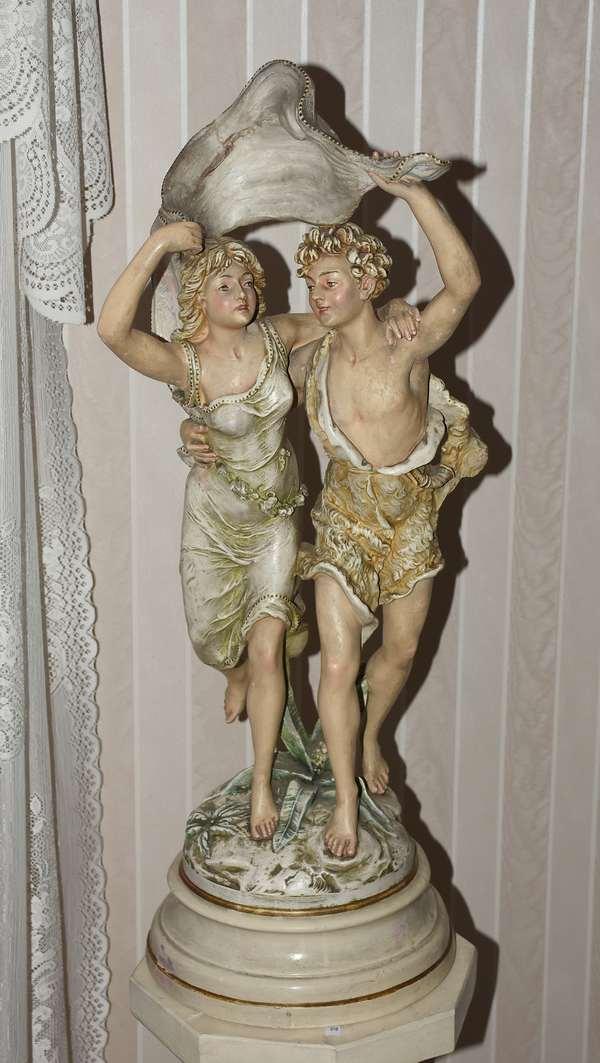 Plaster statue, two figures in rain (900-32)