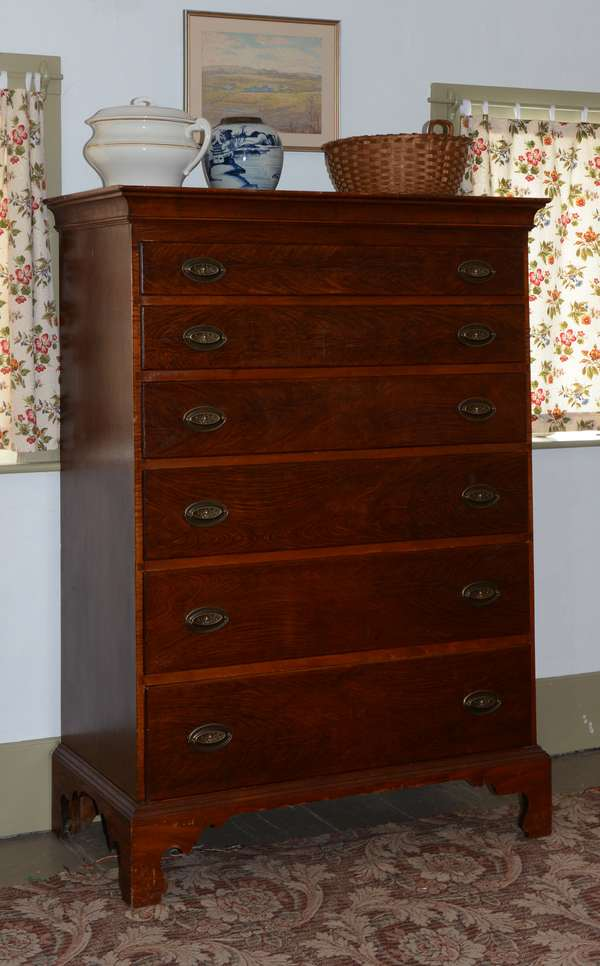 18th C. New England Chippendale six drawer tall chest on bracket feet with grain painted surface, 54