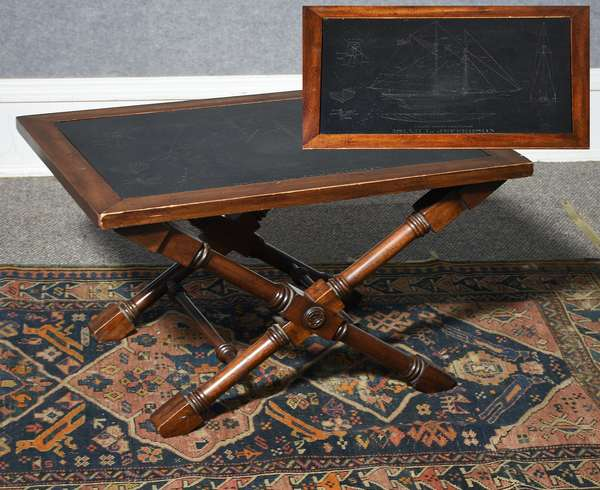 Unique stand, a mahogany X form base with slate insert engraved with a sailing ship, with detail images of the hull and masts