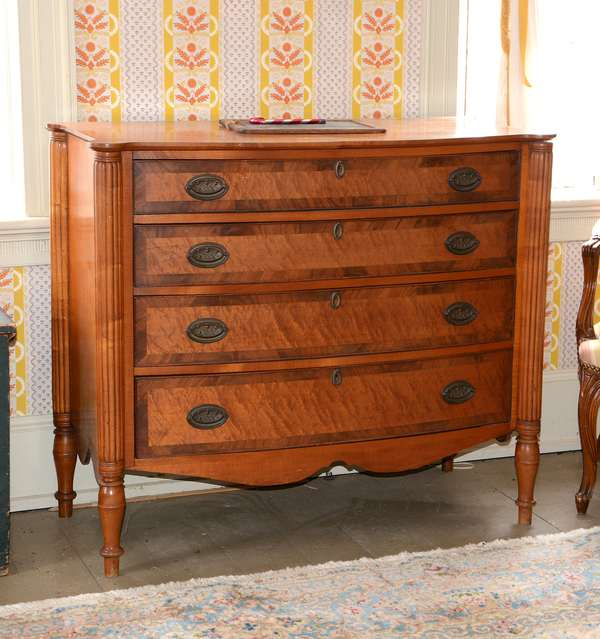 Charming Federal New England cookie corner Sheraton four drawer chest with reeded post, maple with birseye maple drawer fronts and mahogany cross banding, ca.1820, 40