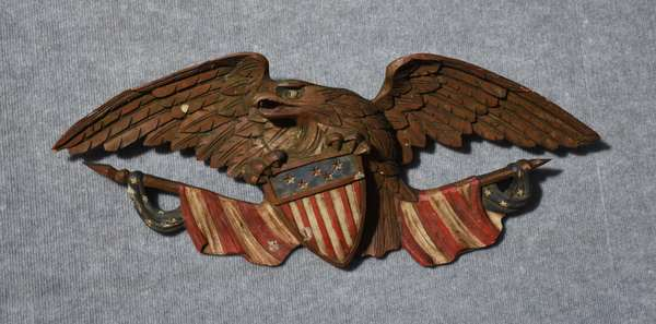 Carved and painted spread wing eagle carving with American flag, 29