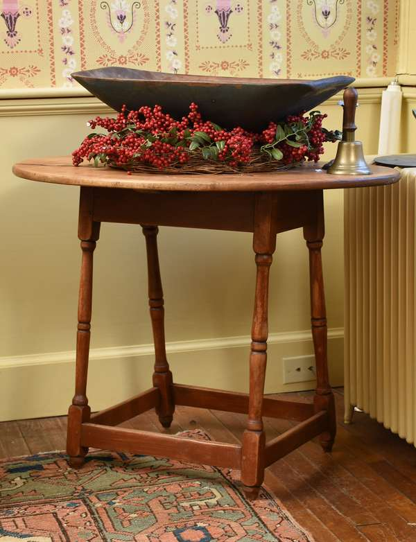 18th C. New England oval top stretcher base maple tavern table with remnants of old red paint, 34